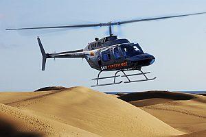 mit dem Hubschrauber über die Dünen von Maspalomas fliegen