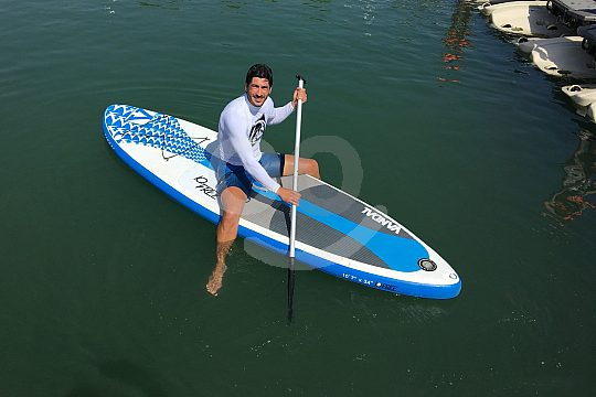 sitting on the Stand Up Paddle Board