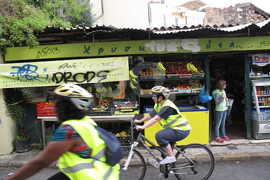 through the streets of Athens by bike