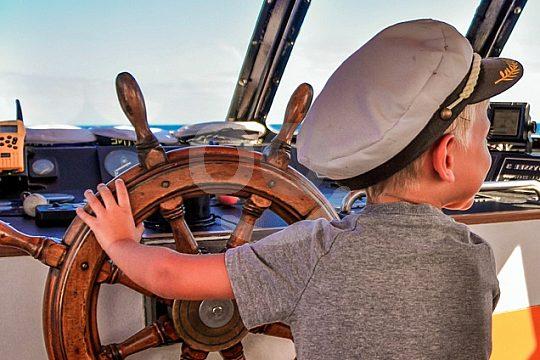 child as captain on the Fuerteventura glass bottom boat trip