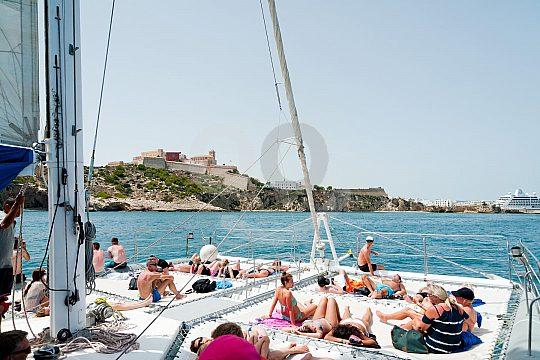Sun on the catamaran deck net to Formentera