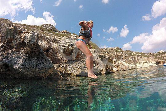 cliff jump during SUP tour in Crete