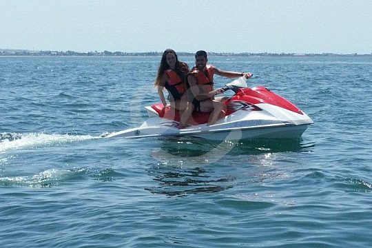 two persons on one jet ski in chipiona
