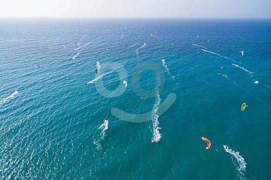 Kitesurfers on the sea