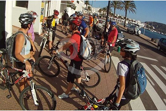 Group of bike riding people in Menorca at the start