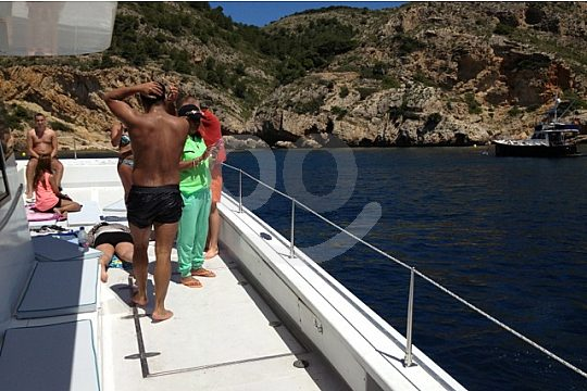 relax on deck during catamaran tour from Denia
