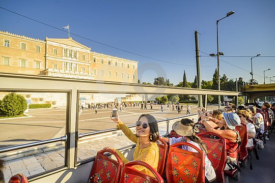 city sightseeing bus in front of the Greek Parliament