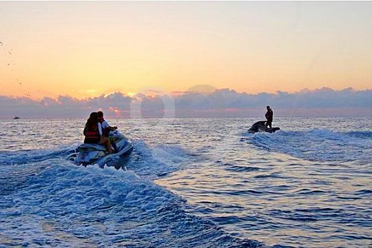 jetskiing during sunset