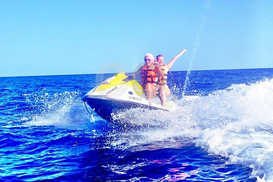 two persons on one jet ski