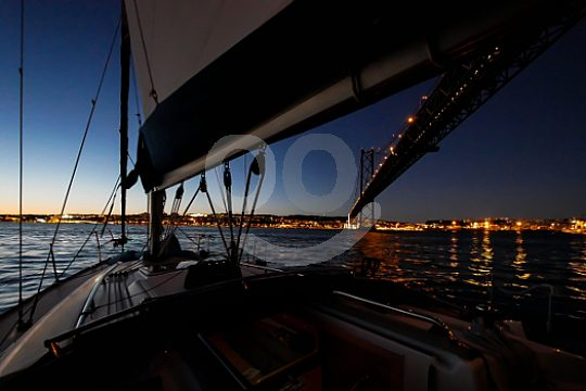 Sail to sunset in Lisbon on Tagus river