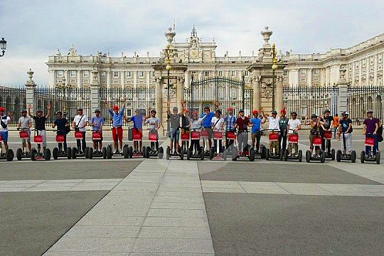 in front of the royal palace of Madrid with Segways
