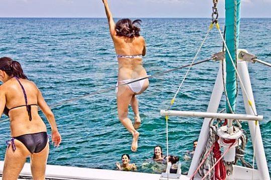swim stop on the catamaran tour from Malaga