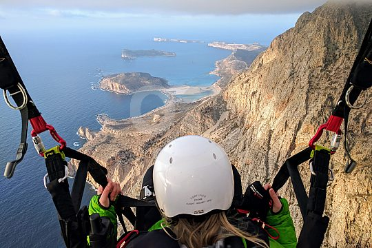 with a paraglider over Crete's coast