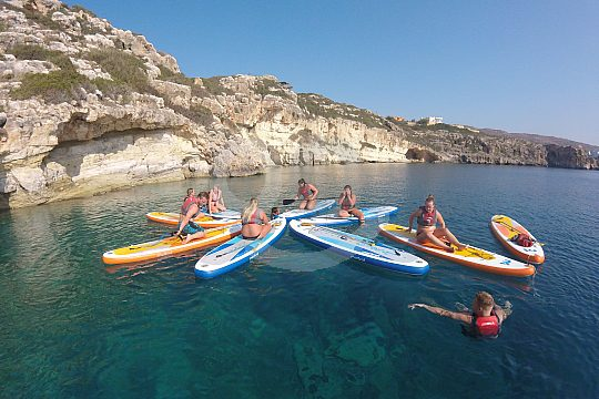 discover Crete's coast in a group while doing SUP
