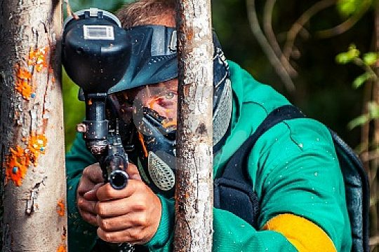 playing paintball on the Costa Verde in a team