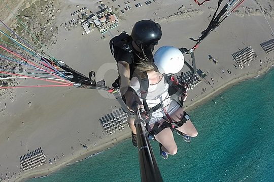 over the Falasarna beach while paragliding