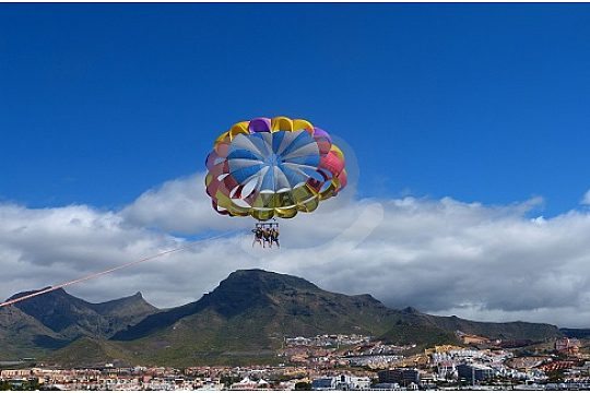 Parasailing fly behind the boat in Tenerife