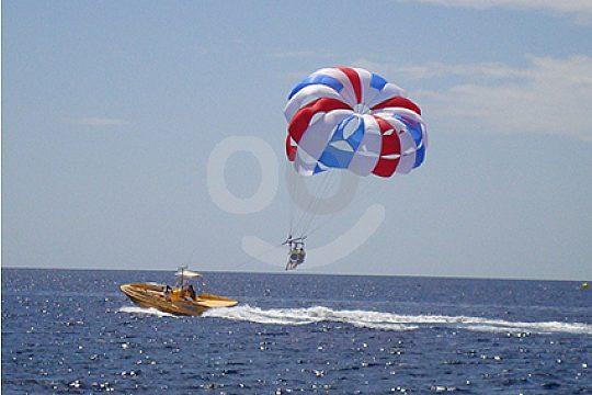 Parasailing behind the boat Lanzarote
