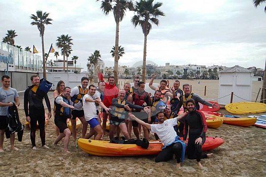 group with the canoe at Malvarrosa beach