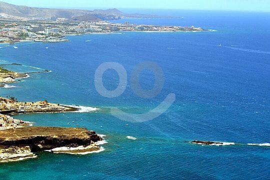 Sightseeing flight Helicopter Panorama Coast Sea Towns Tenerife