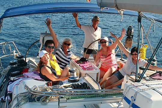 Group on board sailing for the soul