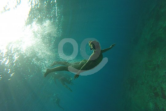 floating in the water while snorkelling in Crete
