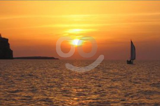 Menorca sailing trip into the sunset