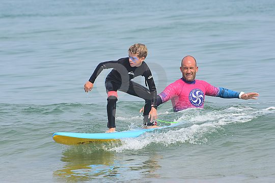 Children learn how to surf in Santander
