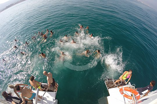 swim stop during a party boat tour in Andalusia