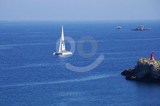 by sailing catamaran from Ibiza to the neighbouring island