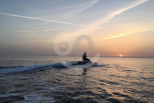 Jetskiing at a unset tour