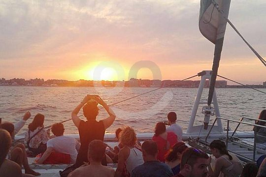 during sunset in Valencia on a catamaran tour