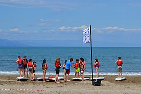 Fun with SUP (Stand Up Paddling) from Riumar Beach at the Ebro Delta in Northeast Spain