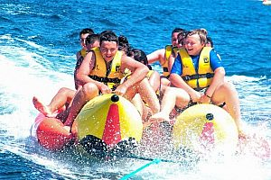 Hunting over the water with a banana boat in Majorca - action on the coast of Calvia