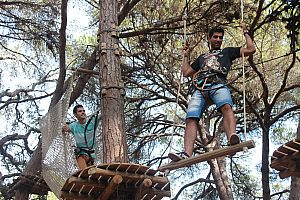 High ropes course in Portugal: climbing between treetops in Figueira da Foz