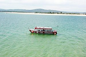 Glass bottom boat islands tour from Olhão, kayaking and lunch at Culatra