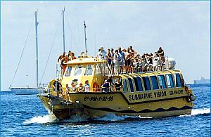 Glass-bottom boat tour in Majorca (southwest) with swim stop at Malgrats islands