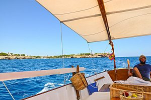 Special boat charter in Mallorca, Portocolom: traditional wooden Llaut boat
