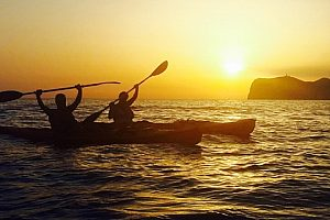 Jump in a kayak and cruise at sunset in Mallorca with a wicked picnic