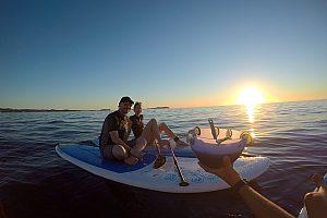Stand Up Paddling (SUP) on Ibiza at sunset - beautiful tour from San Antonio