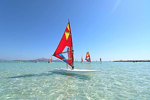 Learn windsurfing in Mallorca or rent a windsurf board at Playa de Muro